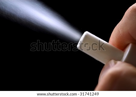 close-up sprayer in hand isolated on black - stock photo