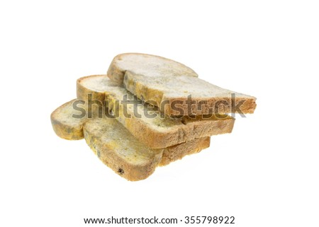 Close up stack of moldy bread isolated on white background - stock photo