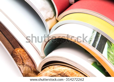 close up stack of the colorful magazines - stock photo