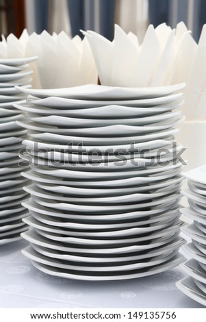 Close up stacks of white color dishes for party time - stock photo