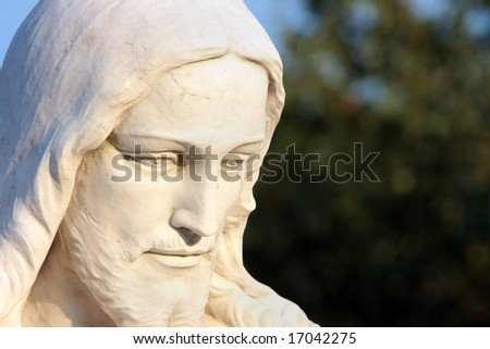 Close up statue of Jesus Christ found in cemetery made of marble with room for text. - stock photo