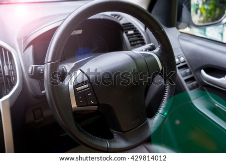Close-up Steering Wheel, Close-up Of A Man Hands Holding Steering Wheel While Driving Car, Sunny day on the road, Interior view of car with black salon - stock photo