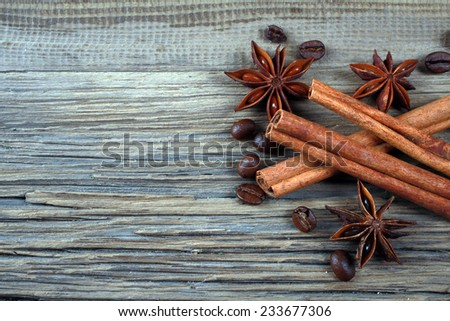 close-up still-life of cinnamon, star anise and coffe on magic Christmas holiday on background wooden boards studio