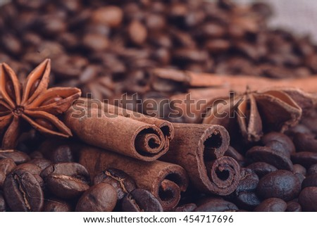 close-up still-life of cinnamon, star anise and coffee on magic Christmas holiday on background wooden boards studio - stock photo