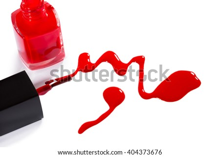 Close Up Still Life of Nail Polish Applicator Brush with Color Drips in Various Shades of Pink and Red on White Background with Copy Space - stock photo