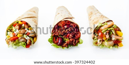 Close Up Still Life of Trio of Tex Mex Fajita Wraps Wrapped in Grilled Flour Tortillas and Filled with Variety of Fillings Such as Chicken, Chili and Shrimp and Fresh Vegetables on White Background - stock photo