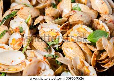 Close up Stir fried clams with roasted chili paste