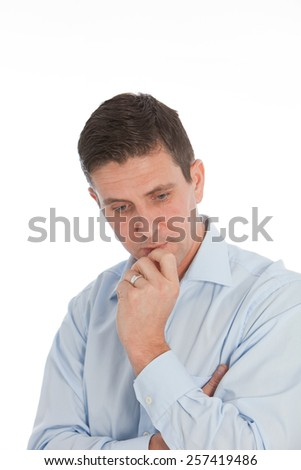 Close up stressed Young Handsome Businessman, with Hand on his Chin and Lips on a White Background. - stock photo