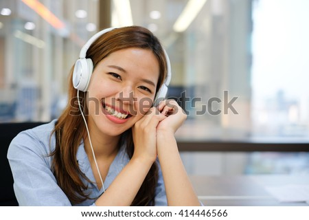 close up student girl listen to music in the library campus university:happy woman with earphones device love to relaxing by music therapy:good life health living concept:attractive charming lady girl - stock photo
