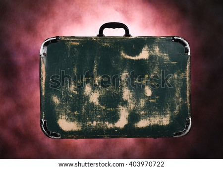 close up studio image of an old and retro leather travel suitcase - stock photo