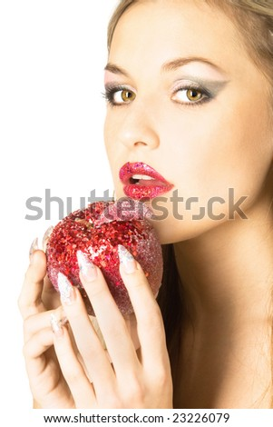 Close-up studio portrait of beautiful sexy young woman with red apple, isolated on white background