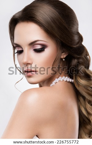 Close-up studio portrait of beautiful woman with bright make-up. Bride. - stock photo