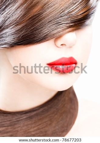 close up studio portrait of young woman, wearing red lipstick