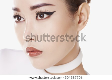 Close up studio portrait young asian model against white background - stock photo