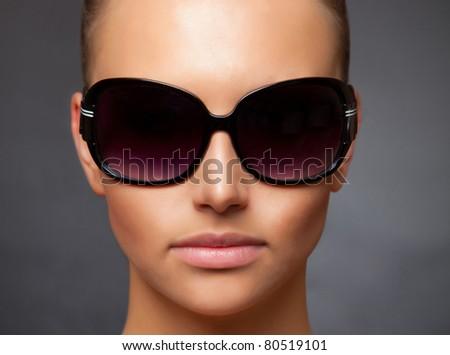 Close up stylish image of caucasian girl wearing sunglasses - stock photo