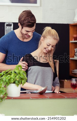 Close up Sweet Young Couple Preparing a Food for Dinner at the Kitchen. - stock photo