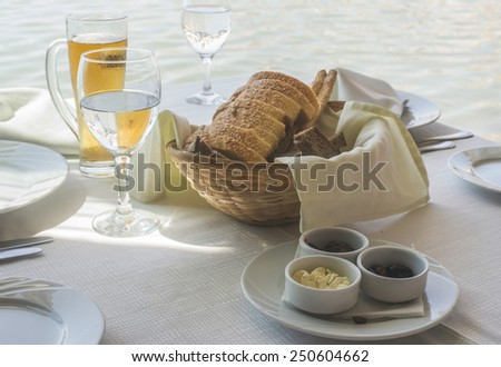 Close up table in greek restaurant. Olives and bread. Greece, Athens, Piraeus - stock photo