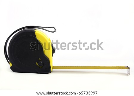 Close up Tape Measure isolated on white background - stock photo