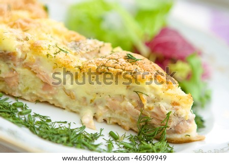close up  tasty home pie with salmon and cheese