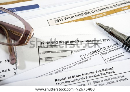 close up taxes documents to completed on a desk with glasses and pen