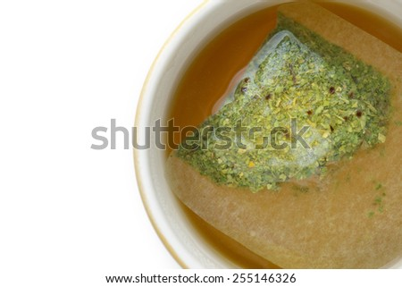 close up tea bag in cup - stock photo