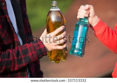Close Up Teenagers Drinking Alcohol Together - stock photo