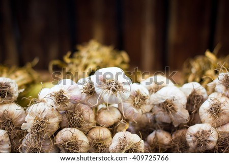 Close up thai garlic bulbs and garlic cloves on bottom view background - stock photo