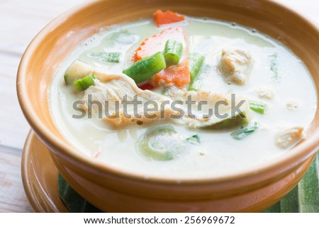 Close up Thai green curry intense soup with chicken  - stock photo