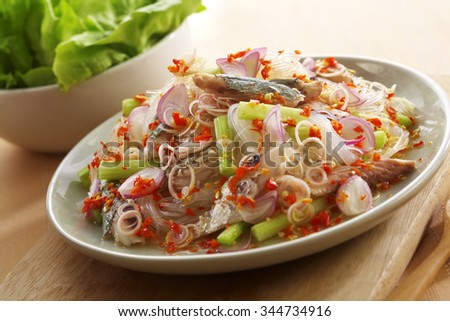 close up thai spicy seafood salad in ceramic dish