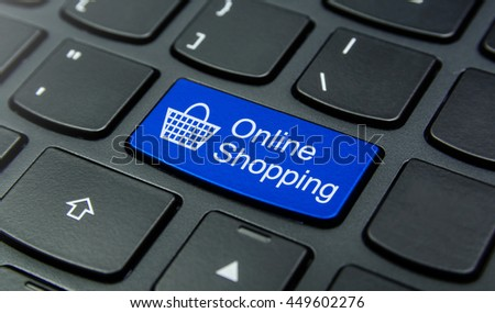 Close-up the Online Shopping with Basket symbol button on the keyboard and have Blue color button isolate black keyboard - stock photo