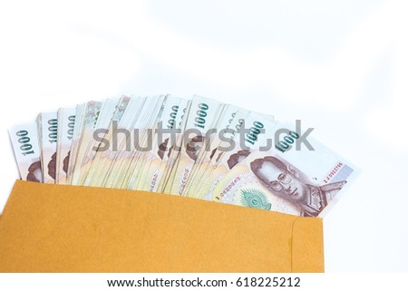 Close up the price of one thousand baht banknotes on a white background.