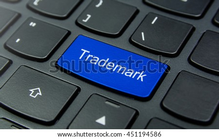 Close-up the Trademark button on the keyboard and have Blue color button isolate black keyboard