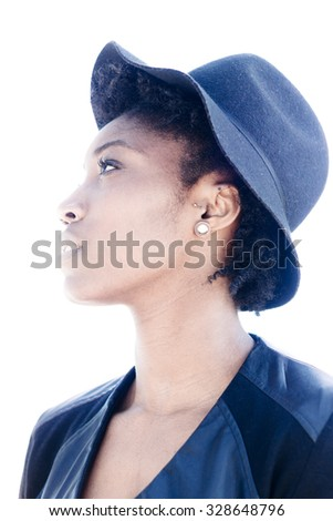 Close up Thoughtful Pretty African Young Woman Wearing Hat, Looking to the Left of the Frame. Isolated on White Background. - stock photo