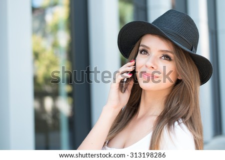 Close up Thoughtful Pretty Young Woman Calling Someone Through Mobile Phone While Looking Up. - stock photo