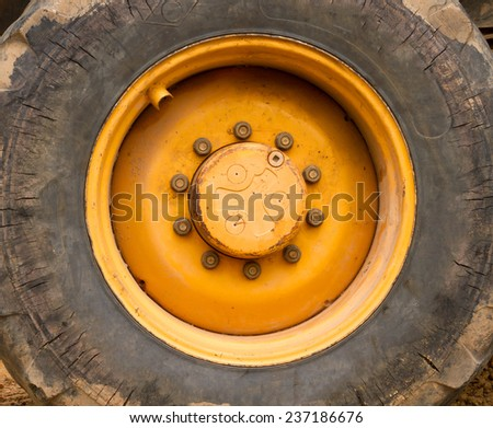 Close up to big heavy tire and wheel  - stock photo