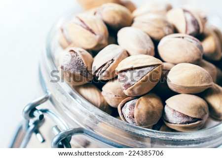 Close up to pistachios in shell,selective focus  - stock photo