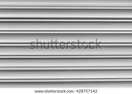 close-up to the shutter door texture in factory entrance,shutter door texture  - stock photo