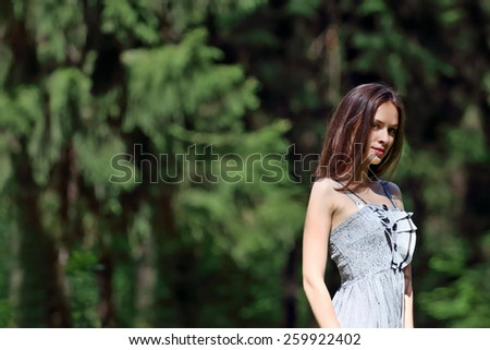 Close up to the waist of beautiful girl in dress with shallow depth of field - stock photo
