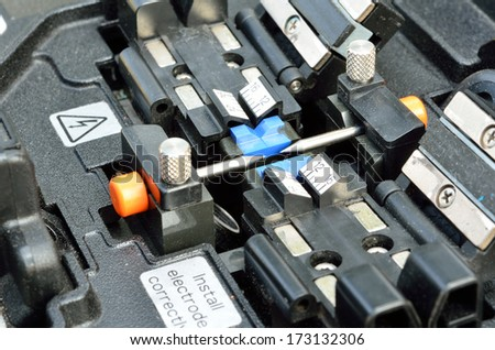 Close up Tool for connecting optical fibers. Welding of optical fibers. - stock photo