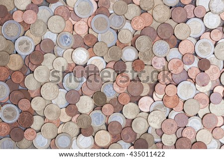Close up top view image of large amount of Euro money coins. - stock photo
