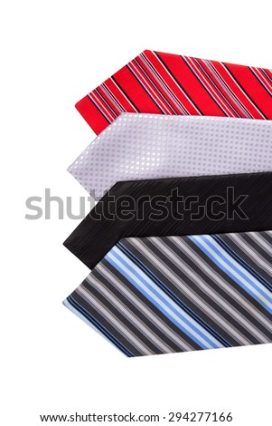Close up top view of colorful men ties side by side, isolated on white background. - stock photo