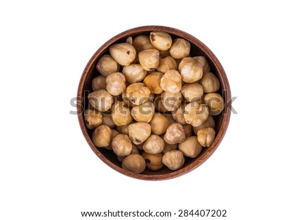 Close up top view of nut in a wooden bowl, isolated on white background. - stock photo