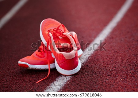 Close-up, top view running shoes for wommen isolated on a racetrack