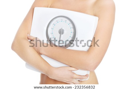 Close up topless woman holding weight.
