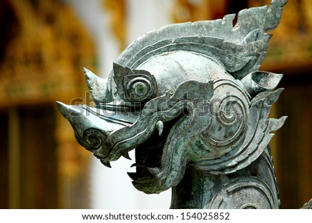 Close-up Traditional Thai style pattern of lion in Thai temple, Bangkok Thailand - stock photo