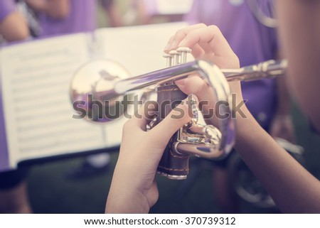 close up trumpet Fragment of pipe and finger,vintage tone - stock photo