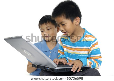 Close up two brother using computer - stock photo