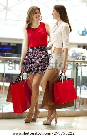 Close up, Two girlfriends with shopping bags