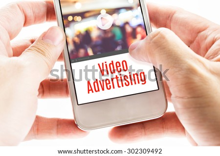 Close up Two hand holding mobile with Video Advertising word, Digital business concept. - stock photo