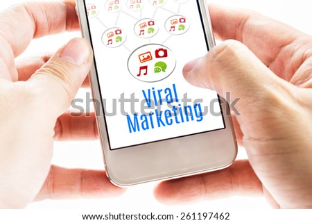 Close up Two hand holding smart phone with Viral Marketing word and icons, Digital concept. - stock photo